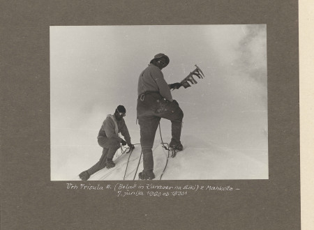 Members of Slovenian Himalayan expedition planting a flag on top of the mountain.