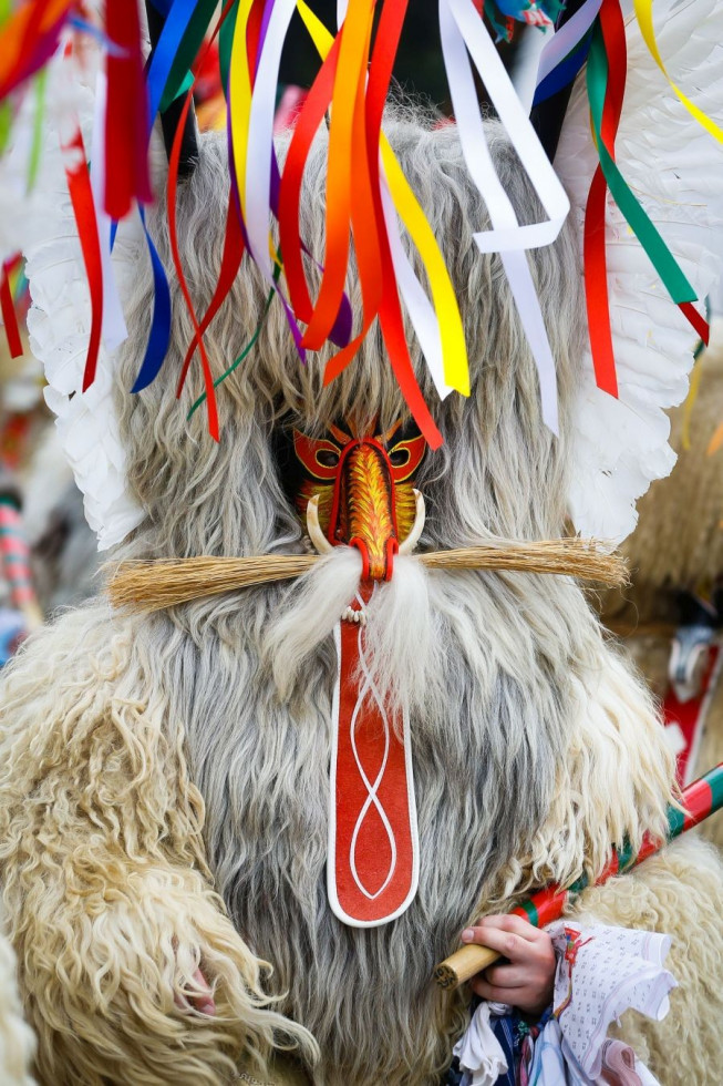 The kurent, who resembles a demon, is clothed in sheepskin, and around his belt hang large cowbells and beautifully embroidered handkerchiefs