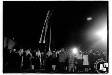 Raising of Slovenian Flag, a crowd of people, some in national costumes
