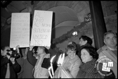 People with torches and signs.